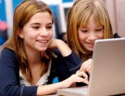Two girls at a computer